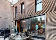 Rear yard creates a cool private escape and playarea for kids 217x155 Twin Rooftop Volumes Rejuvenate 1930s Duplex in Montreal's Little Italy