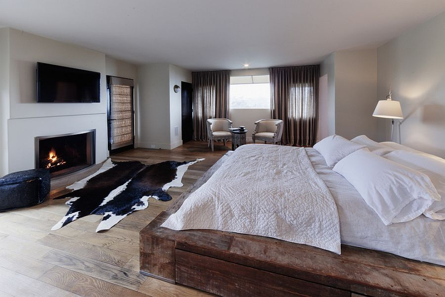 Reclaimed wooden platform bed for the modern rustic bedroom [Design: Devall Designs & Home]