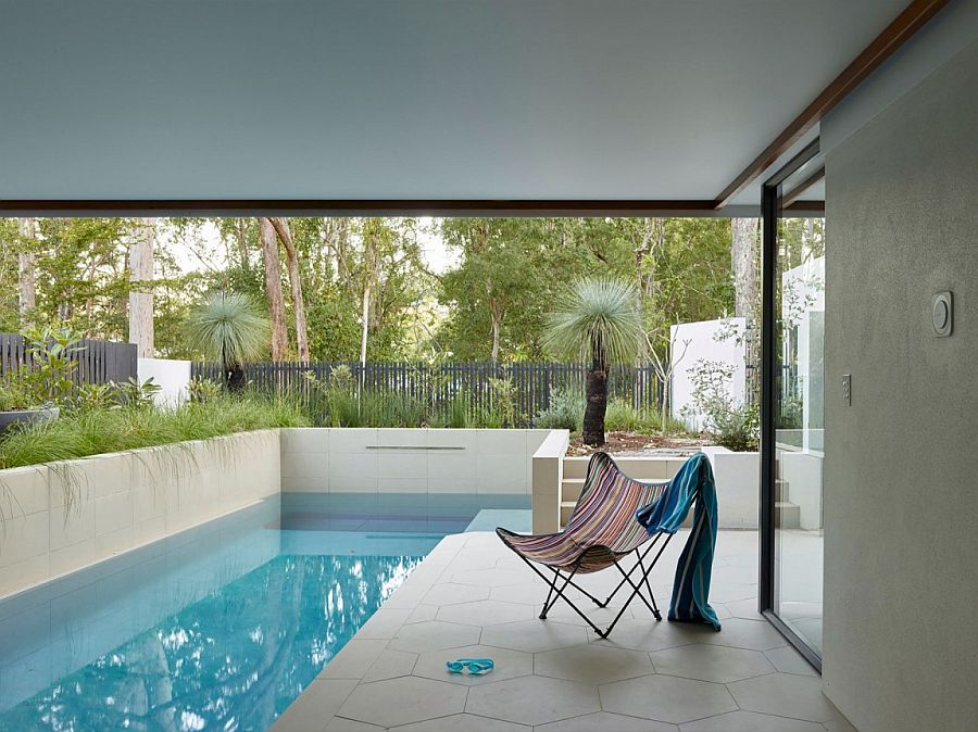 Relaxing poolside area of the Bardon home with a simple deck