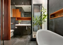 Restrained use of wooden elements bring cozy elegance to the concrete bathroom