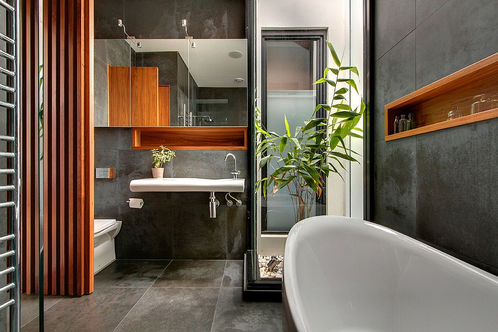 Restrained use of wooden elements brings cozy elegance to the concrete bathroom [Design: LSA Architects]