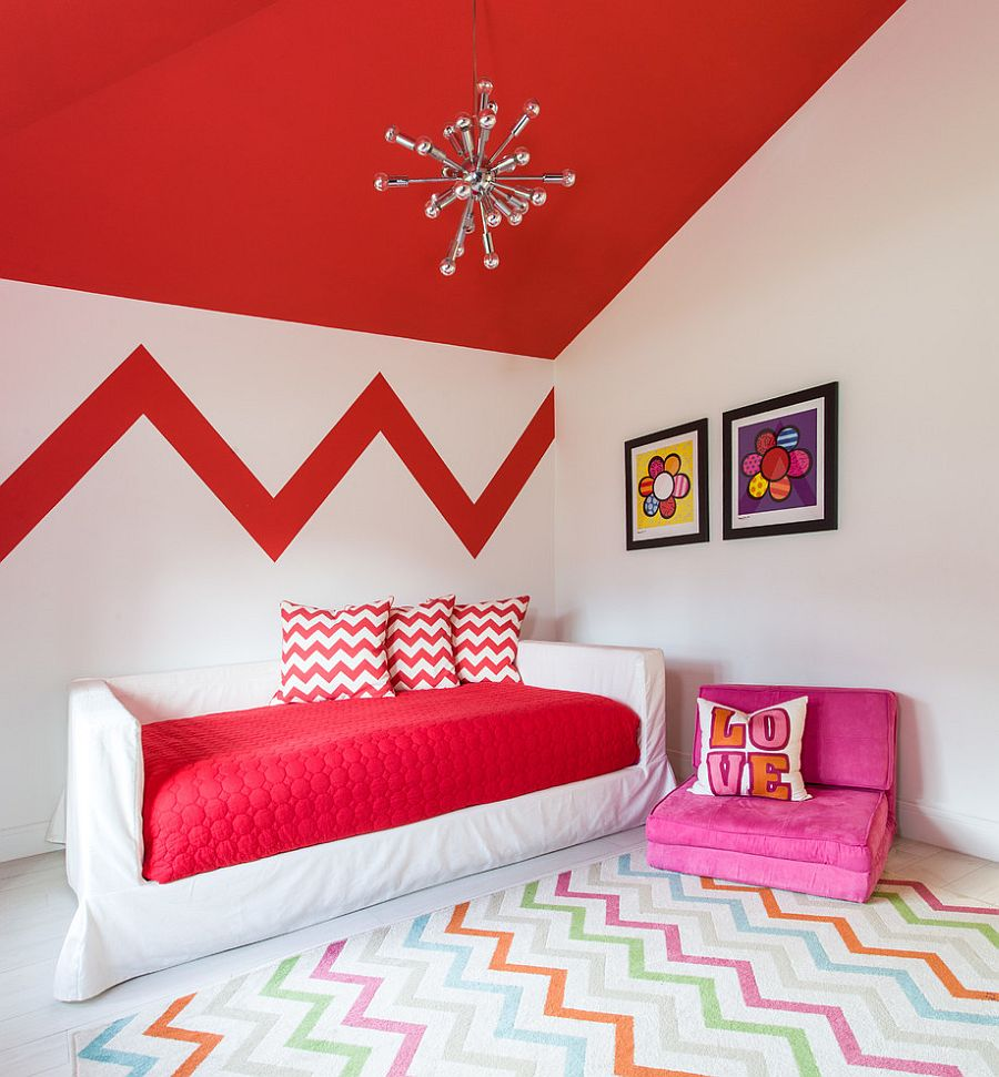 Rug, accent pillows and feature wall add chevron pattern to the stylish kids room [Design: B.Design]