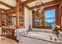 Rustic bathroom with stone bathtub and lovely mountain views