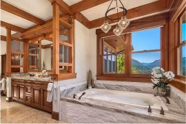 Rustic bathroom with stone bathtub and lovely mountain views 270x180 Framed to Perfection: 15 Bathrooms with Majestic Mountain Views