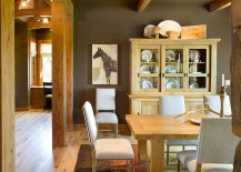 Rustic dining room with a fabulous china hutch that complements its style perfectly