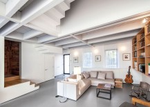 Sectional in the living room helps delineate and define the open space