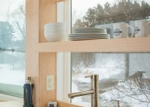 Shelves in the kitchen utilize vertical space without blocking the view