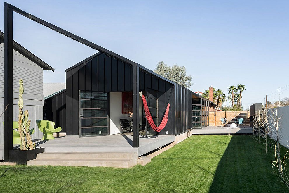 Shipping container styled extension in the rear of Arizona home