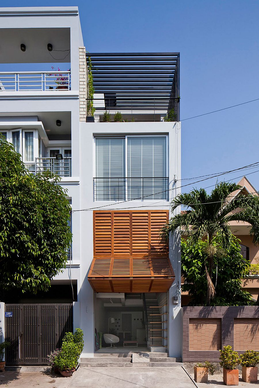 Ingenious townhouse in saigon is an enigmatic light for Townhouse architecture designs