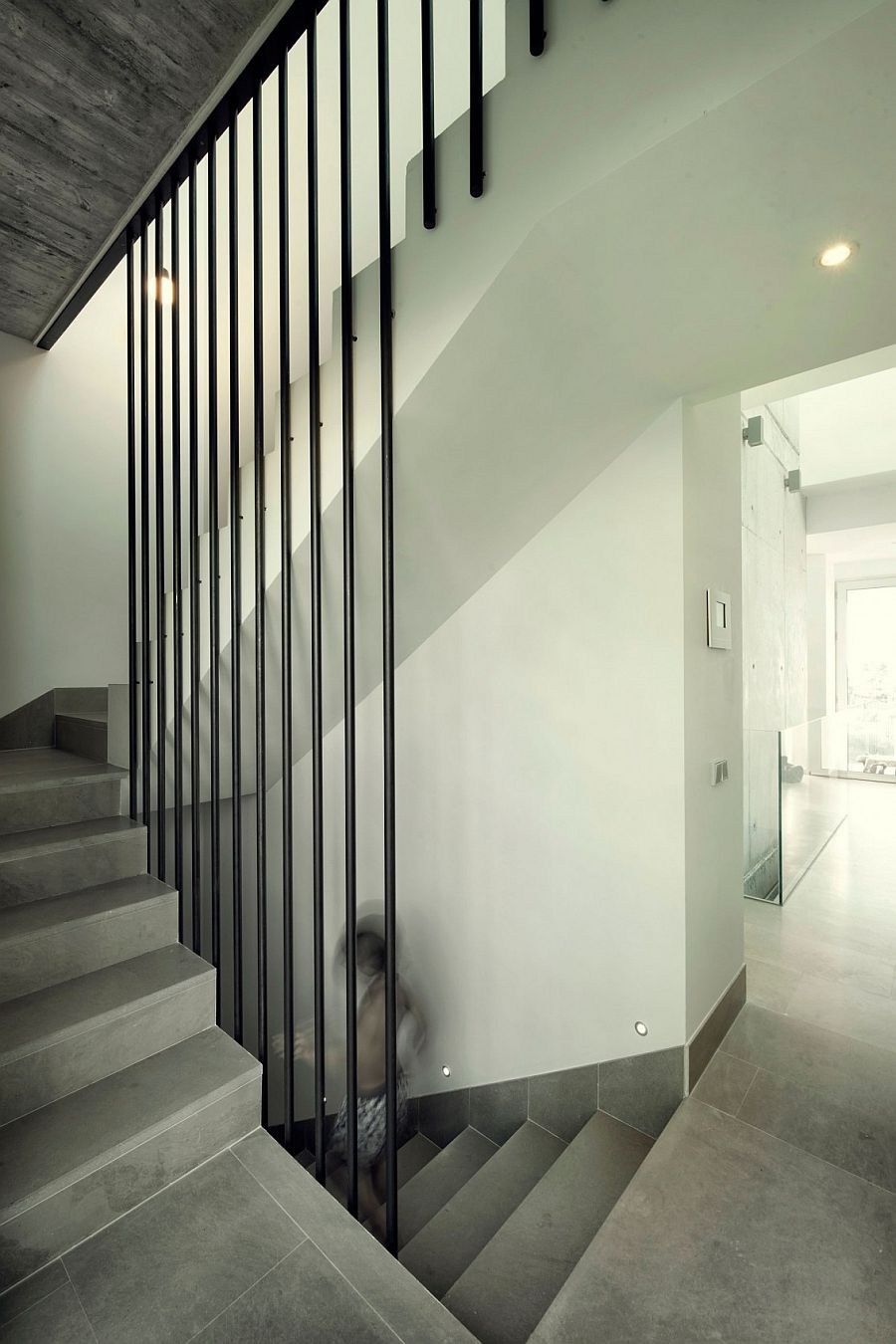 Simple staircase connects the various levels of the home in Algeciras, Spain