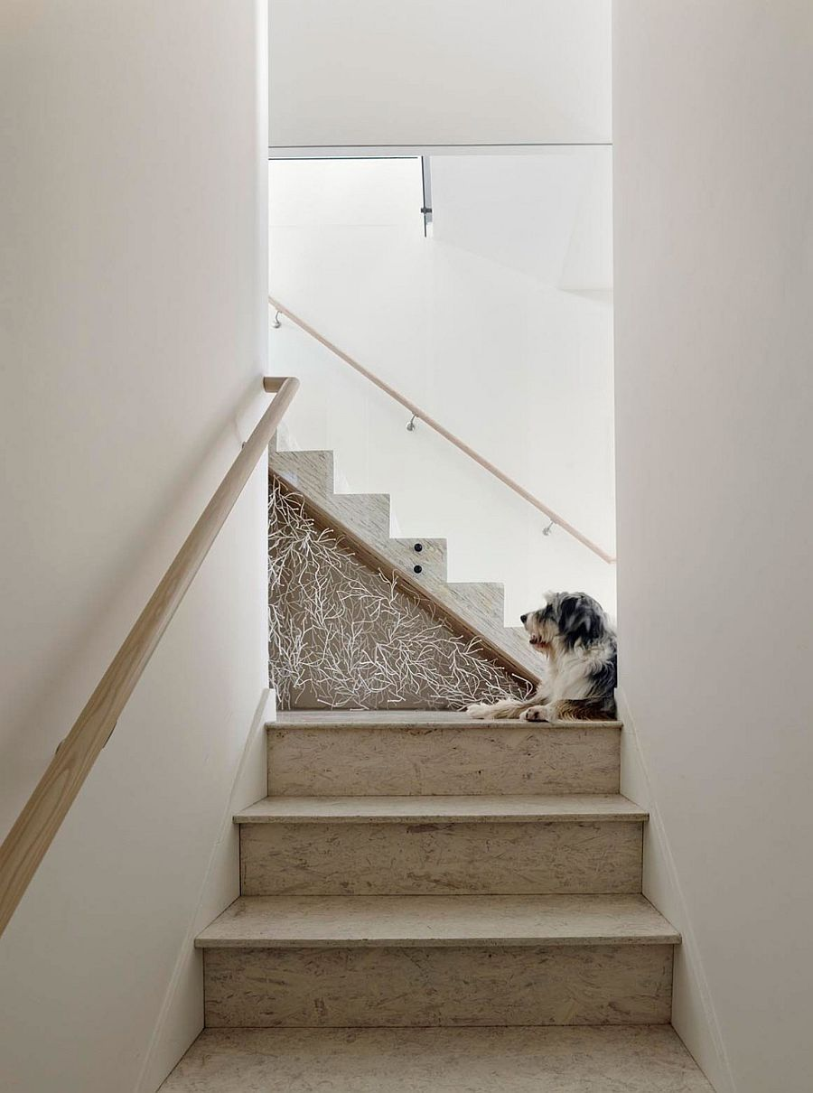 Simple staircase design draped in minimal hues and stone steps
