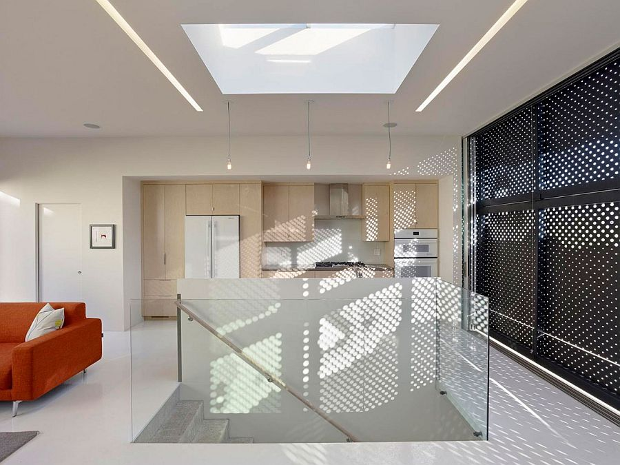 Skylight above the staircase brings natural light to even the lower levels of the house