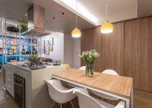 Sliding doors in the dining area conceal the home office