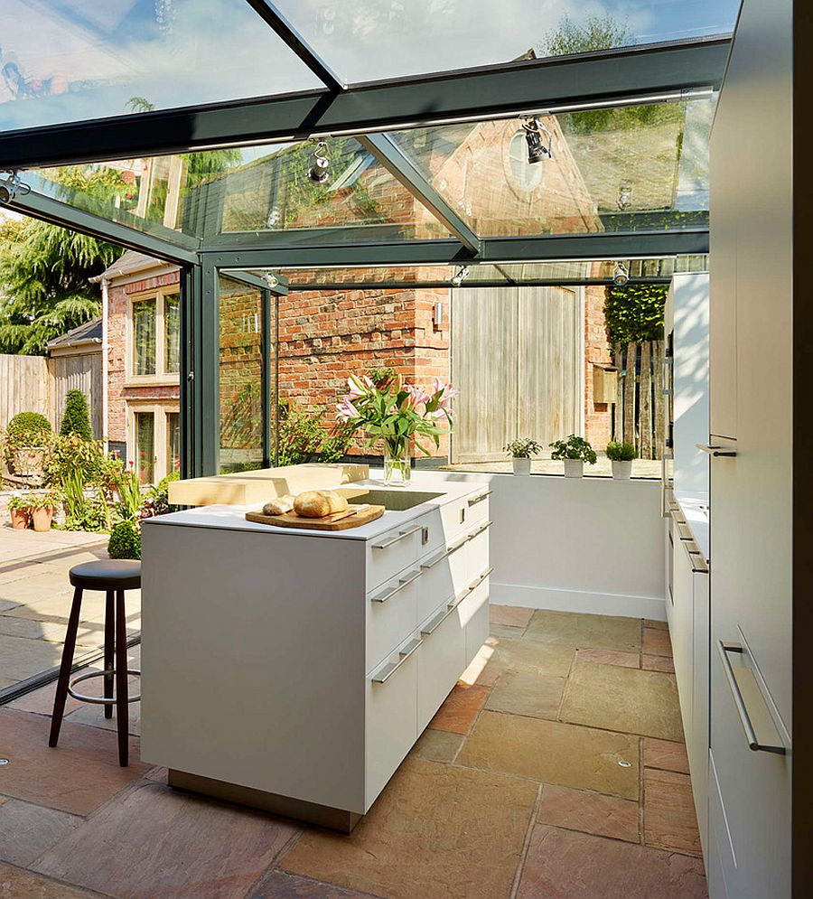 Sliding glass doors open up the kitchen to the garden