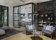 Sliding glass walls delineate the living area from the dining room