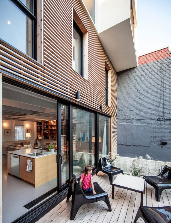 Rear yard creates a cool private escape and playarea for for Home renovation montreal