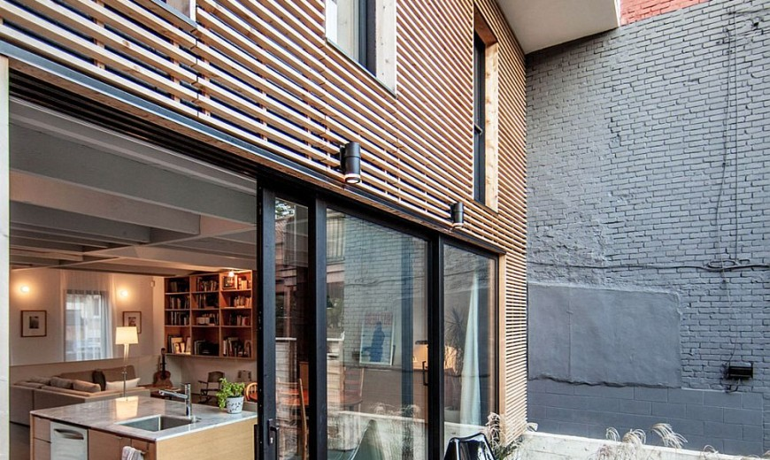 Twin Rooftop Volumes Rejuvenate 1930s Duplex in Montreal's Little Italy