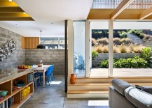 Smart dining space and living area connected with the sunny rear courtyard