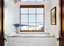 Snow-covered peaks greet you at this luxurious trasitional bathroom