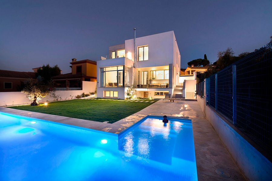 Spacious backyard and L-shaped pool of luxury Spanish residence