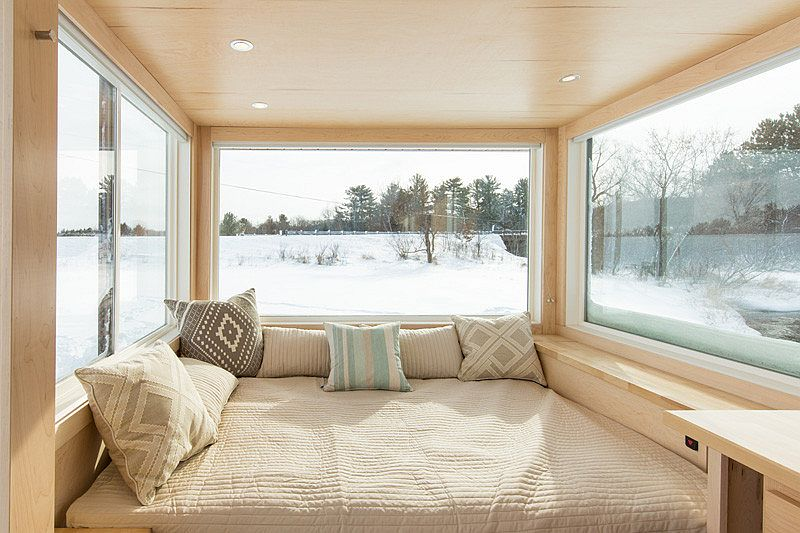 Spacious bed inside the 160 sqaure foot tiny home on wheels