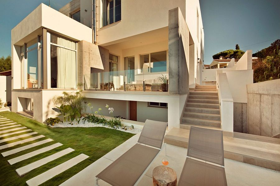 Spacious deck, backyard and pool area of the Spanish home