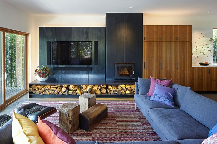 Stacked firewood adds textural contrast to the contemporary interior