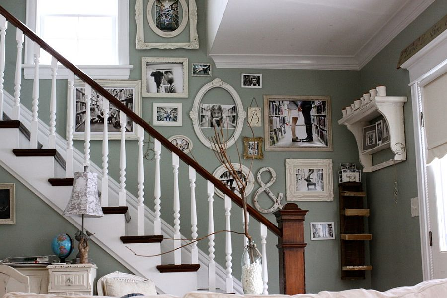 Staircase wall filled with family photos [Design: Kasey Buick]