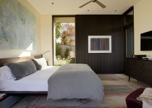 Steel and corrugated siding brings industrial deisgn to contemporary bedroom