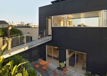 Steel-catwalk-connects-the-top-floor-directly-to-the-rear-garden-217x155