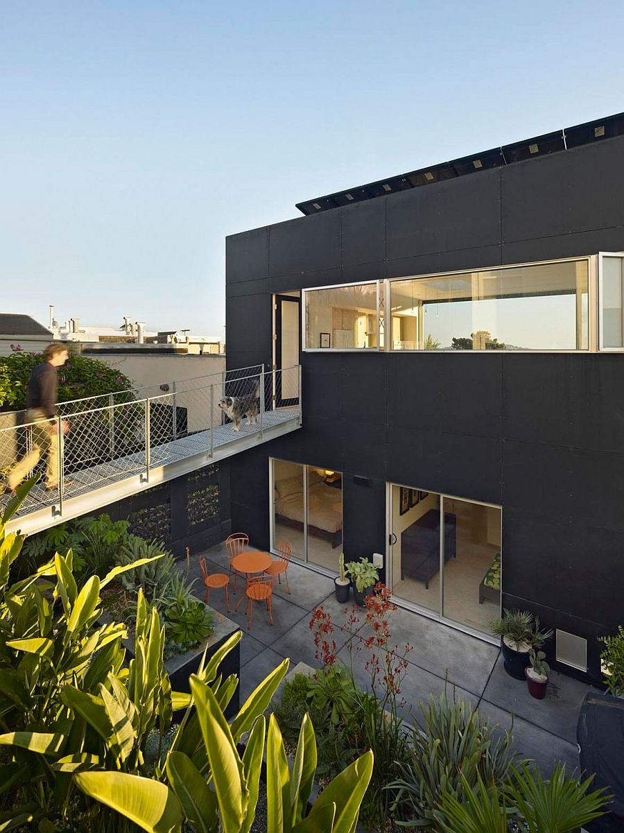 Steel catwalk connects the top floor directly to the rear garden