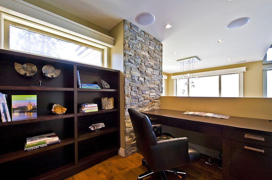 Stone wall architectural feature for the mezzanine level home office [Design: Begrand Fast Design]