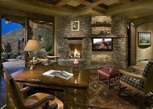 Stone wall with fireplace and TV becomes the showstopper in this home office