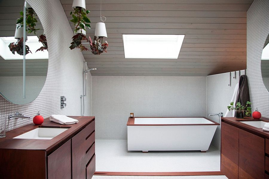 Stunning attic level bathroom with a skylight