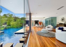 Stunning living area of the Sydney home becomes one with the pool outside