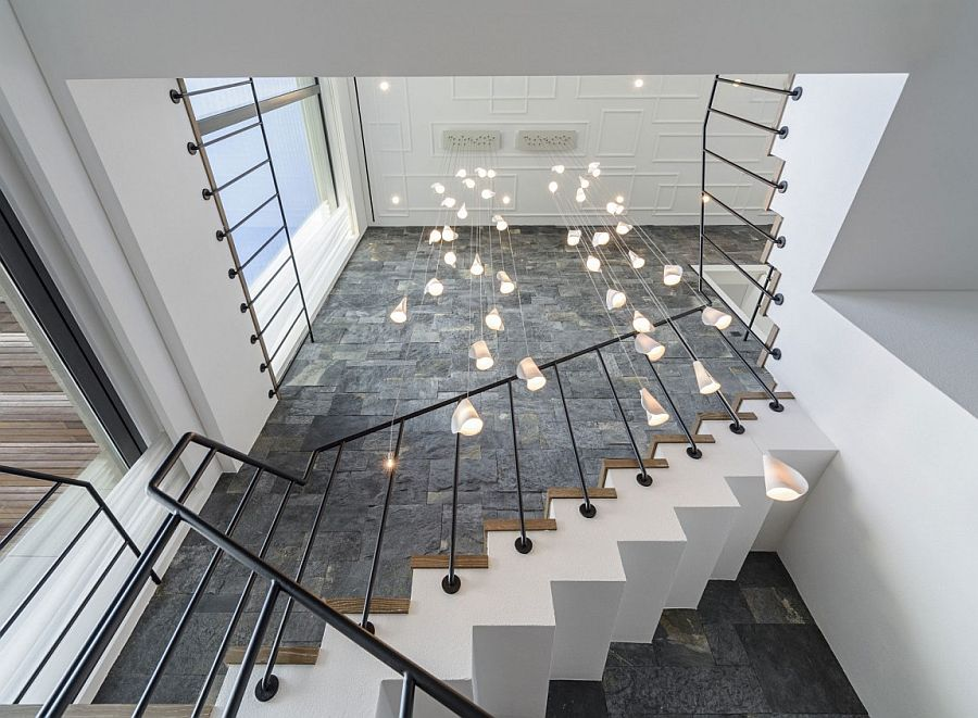 Stunning use of cascading chandelier at the staircase