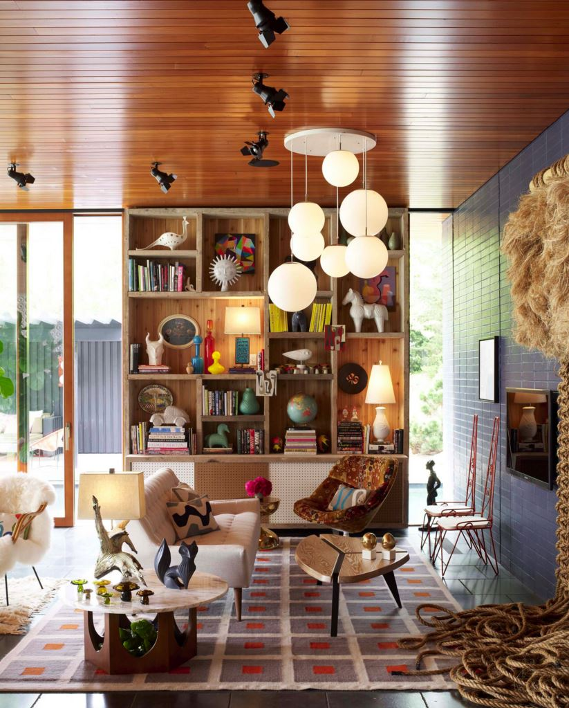 Styled bookshelf featuring treasures by Jonathan Adler