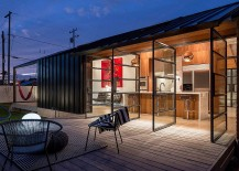 Swiveled-glass-doors-connect-the-interior-with-the-small-deck-217x155