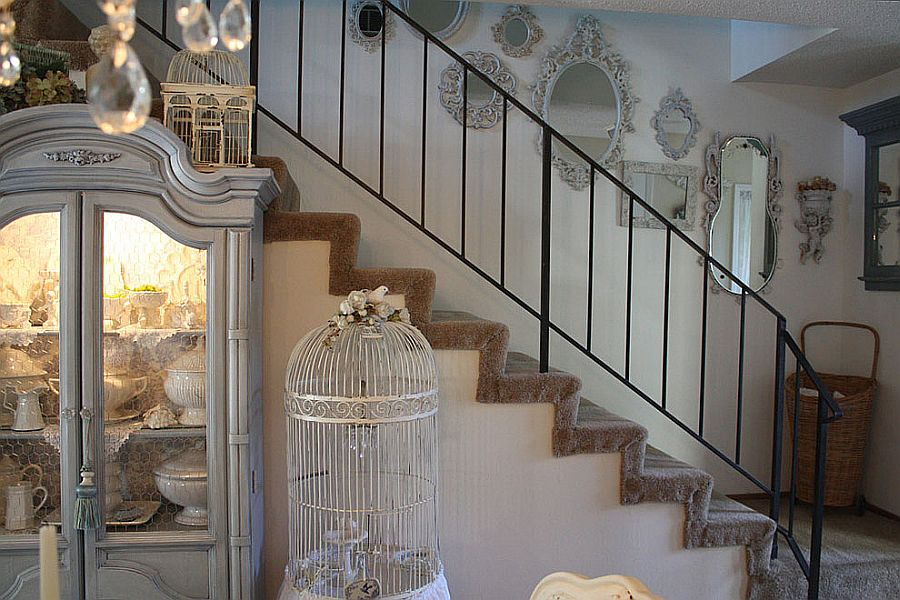 Thrift store and flea market finds with common hue create a beautiful staircase wall