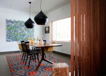 Tom Dixon pendant ligting for the modern dining room with bespoke table and colorful rug