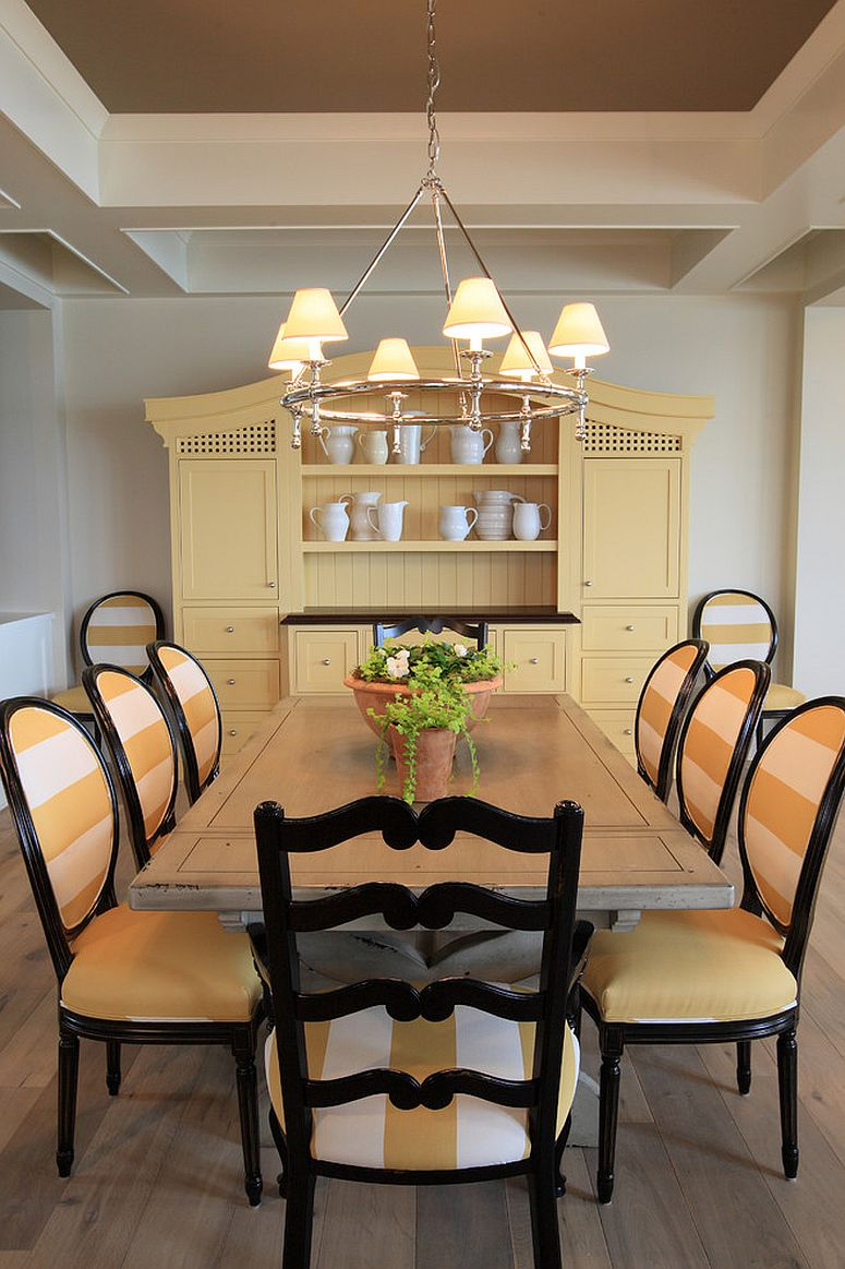 traditional dining room in yellow and black with a large hutch design