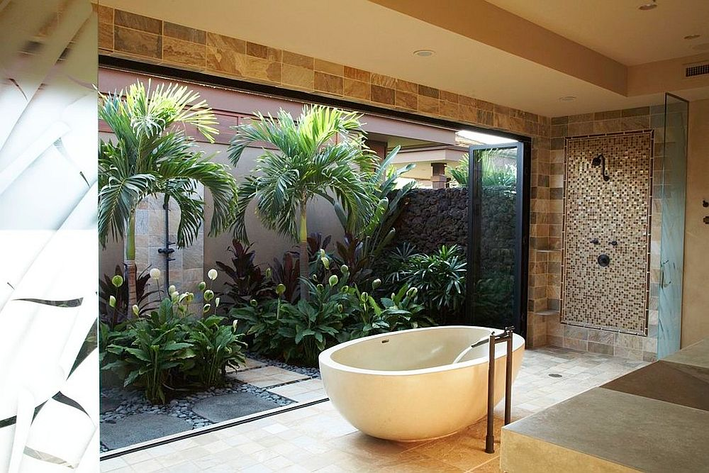 Tropical bathroom brings the outdoor garden inside with folding glass doors [Design: Knudson Interiors]