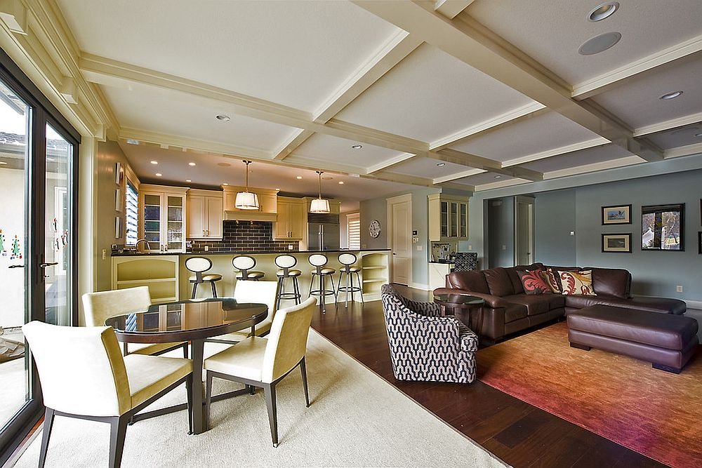 Try out a simple change of color for different spaces in the open floor plan