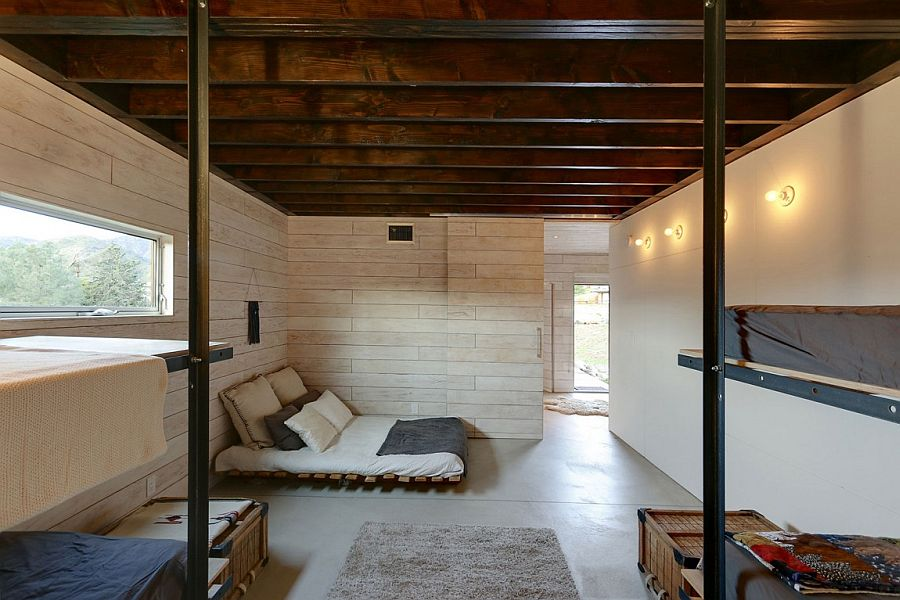 Unique design of beds and use of recycled materials adds to the appeal of stylish cabin