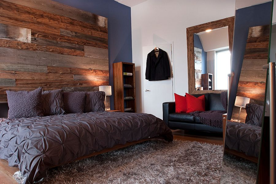 Urbane bedroom with reclaimed wood accent wall and organic bedding in gray [Design: Groundswell Design Group]
