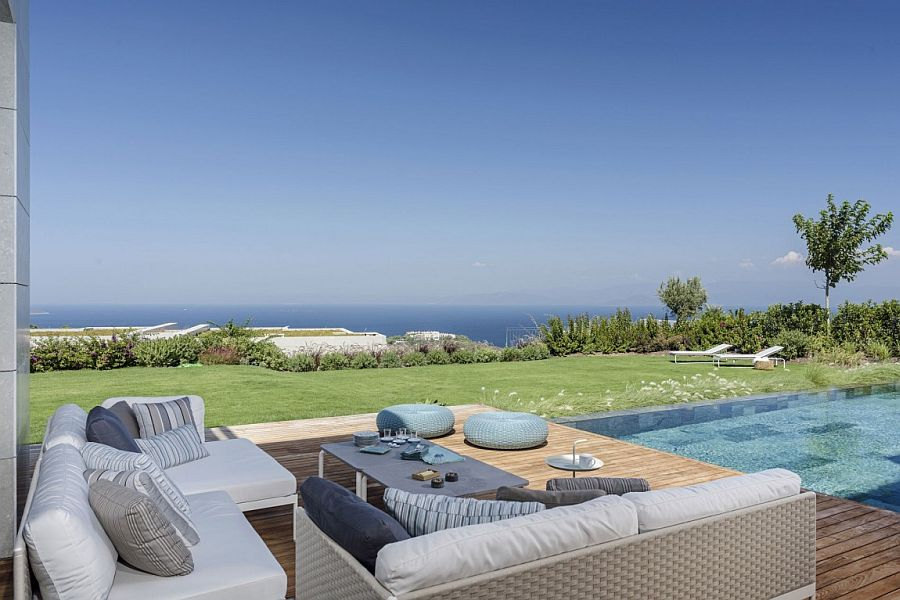 View of the distant coastline from the pool area of Y House Y House: Trendy Mediterranean Retreat with Modern Sophistication