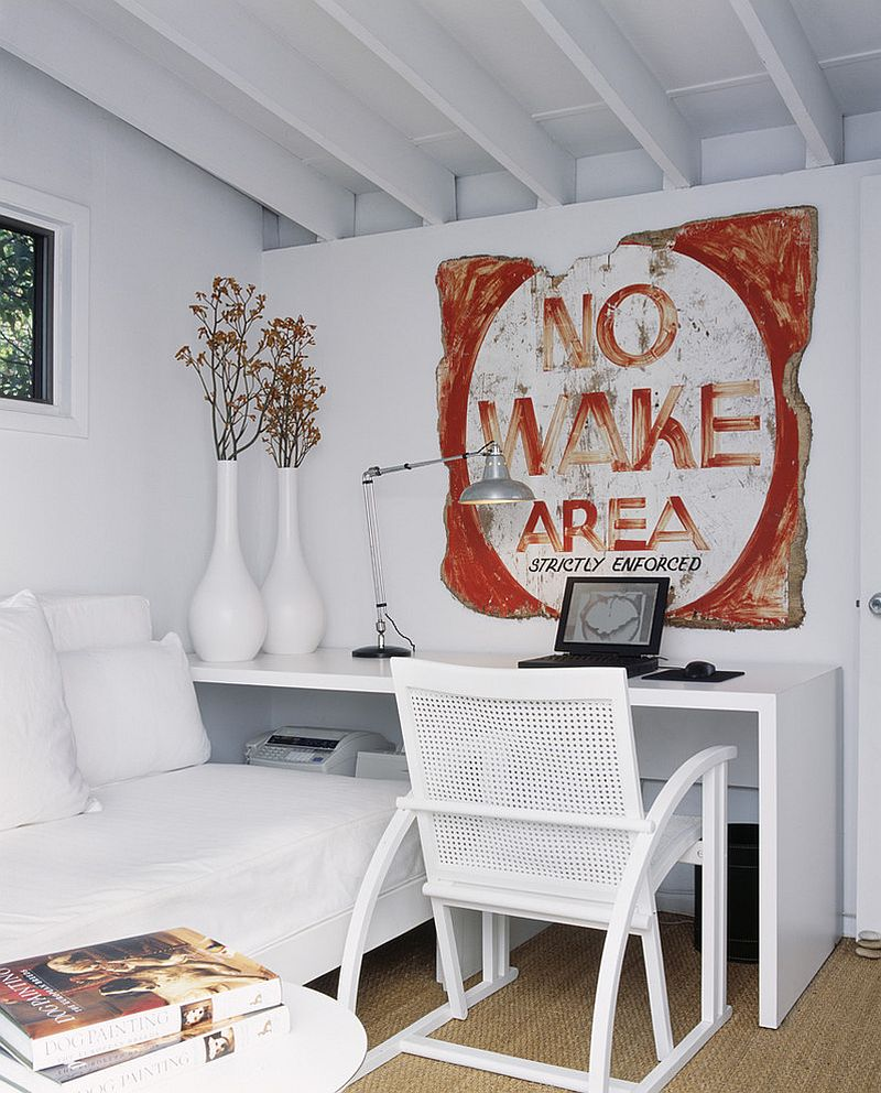 Vintage sign adds color to the white home office [Design: Bruce Bierman Design]
