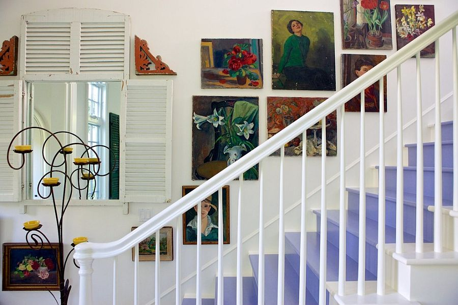 Wall art adds to the shabby chic style of the staircase in white [Design: Alison Kandler Interior Design]
