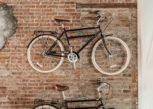 Wall-mounted bicycles alse serve as dramatic decorative pieces when set against a brick wall in the living room