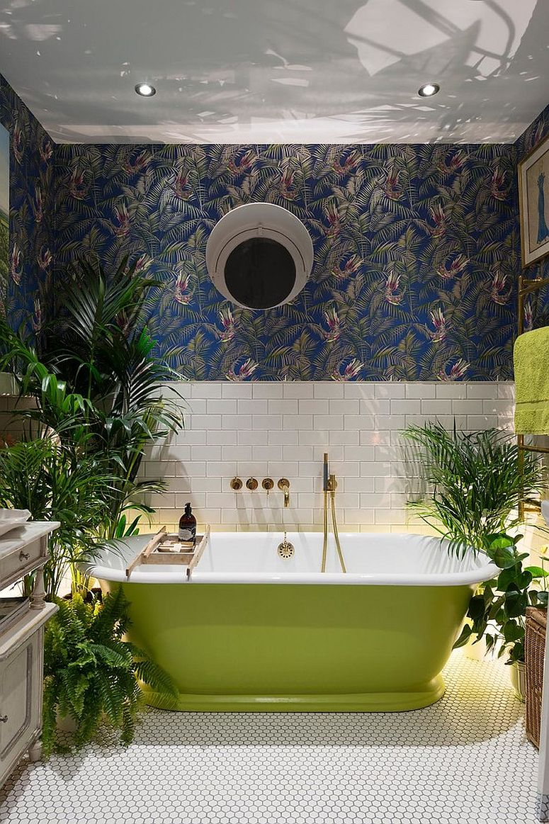 Wallpaper and plants create a jungle-inspired environment inside the eclectic bathroom [Design: Alexander Owen Architecture]